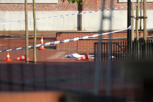 A blanket on the ground in the area around a police building after a man wounded two policewomen with a machete in the southern Belgian city of Charleroi