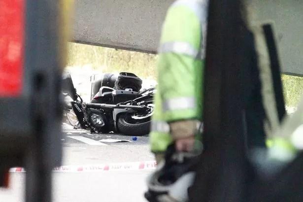 M20 bridge collapse motorcycles caught under the bridge