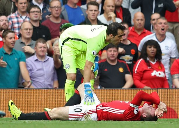 Manchester United's Wayne Rooney after a challenge with Manchester City's Claudio Bravo