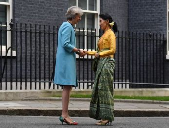 British Prime Minister Theresa May (L) greets Myanmar's State Counsellor Aung San Suu Kyi outside 10 Downing Street