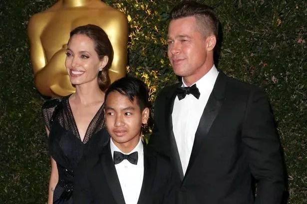 Angelina Jolie, Maddox Jolie-Pitt and actor Brad Pitt