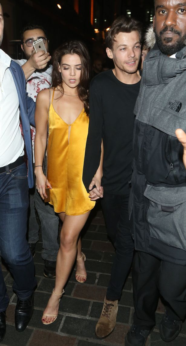 Louis Tomlinson and Danielle Campbell seen here leaving Cirque le Soir nightclub at 4am in London after he performed at the Pride Of Britain awards