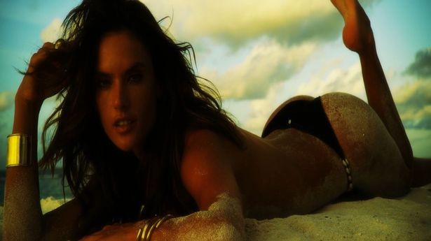 Victoria's Secret angel Alessandra Ambrosio strips off in a sizzling behind-the-scenes Internet video while shooting a photo shoot for 'GQ' magazine in her home country of Brazil