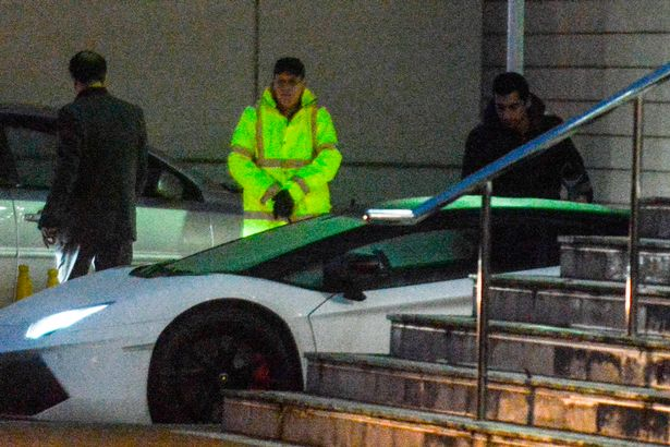 Henrikh Mkhitaryan leaves the Lowry Hotel in his supercar