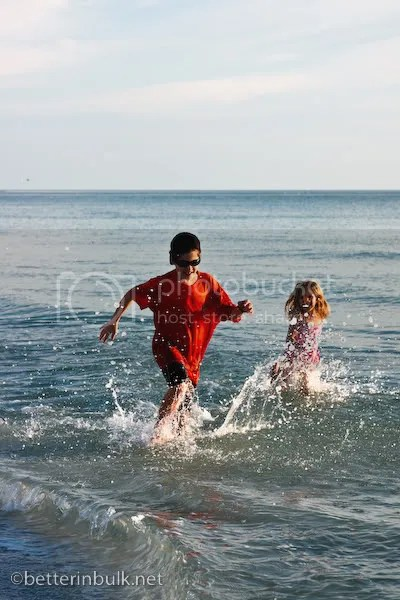 girl running in ocean Florida December