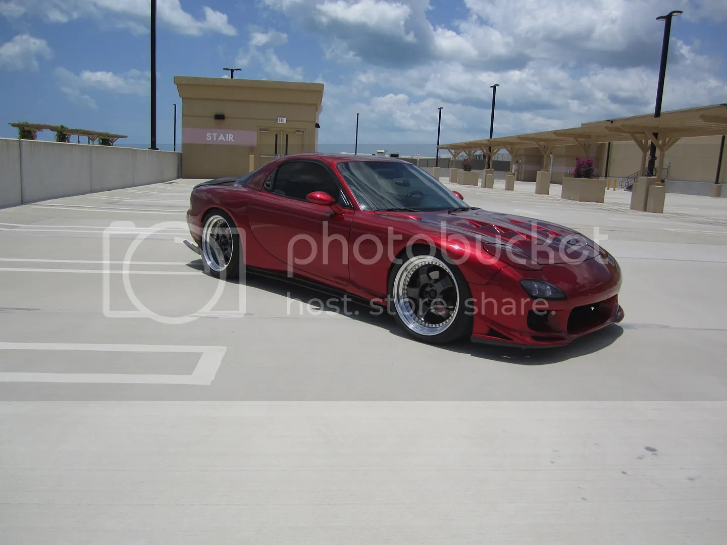 Okay, I used Red Rocket in the last post; the car had no name and was more of a burgundy. But a 1990s-era RX7, he was. Not quite a fancy as this one, but you get the idea. Photo courtesy rx7club.com