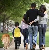 A family unit on a stroll.