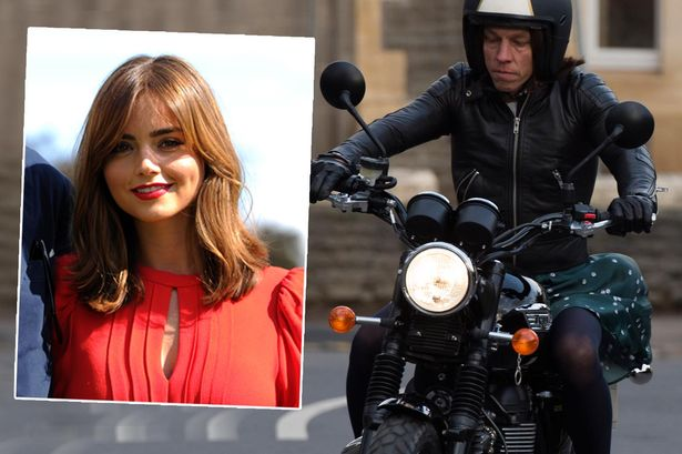 A male stunt double films as Doctor Who character Clara Oswald on a motorbike near the Mercure Hotel off Newport Road, Cardiff, and (inset) the real Clara