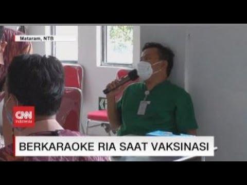 Berkaraoke Ria Saat Vaksinasi