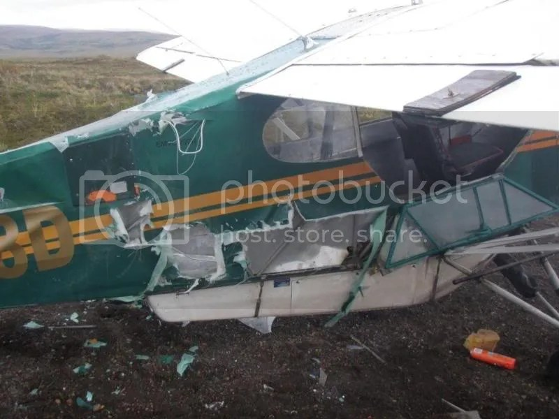 Light aircraft with its fabric fuselage ripped open.