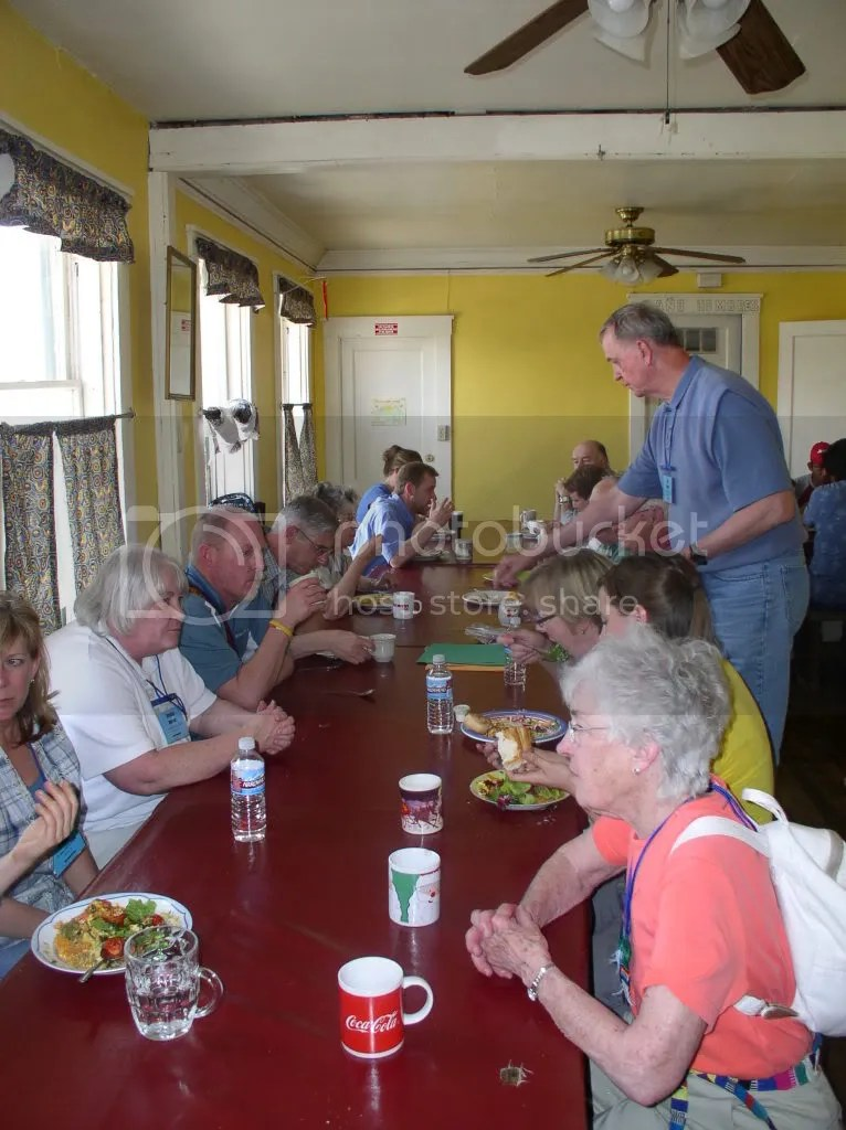 Lutheran guests share in the meal provided at Annunication House