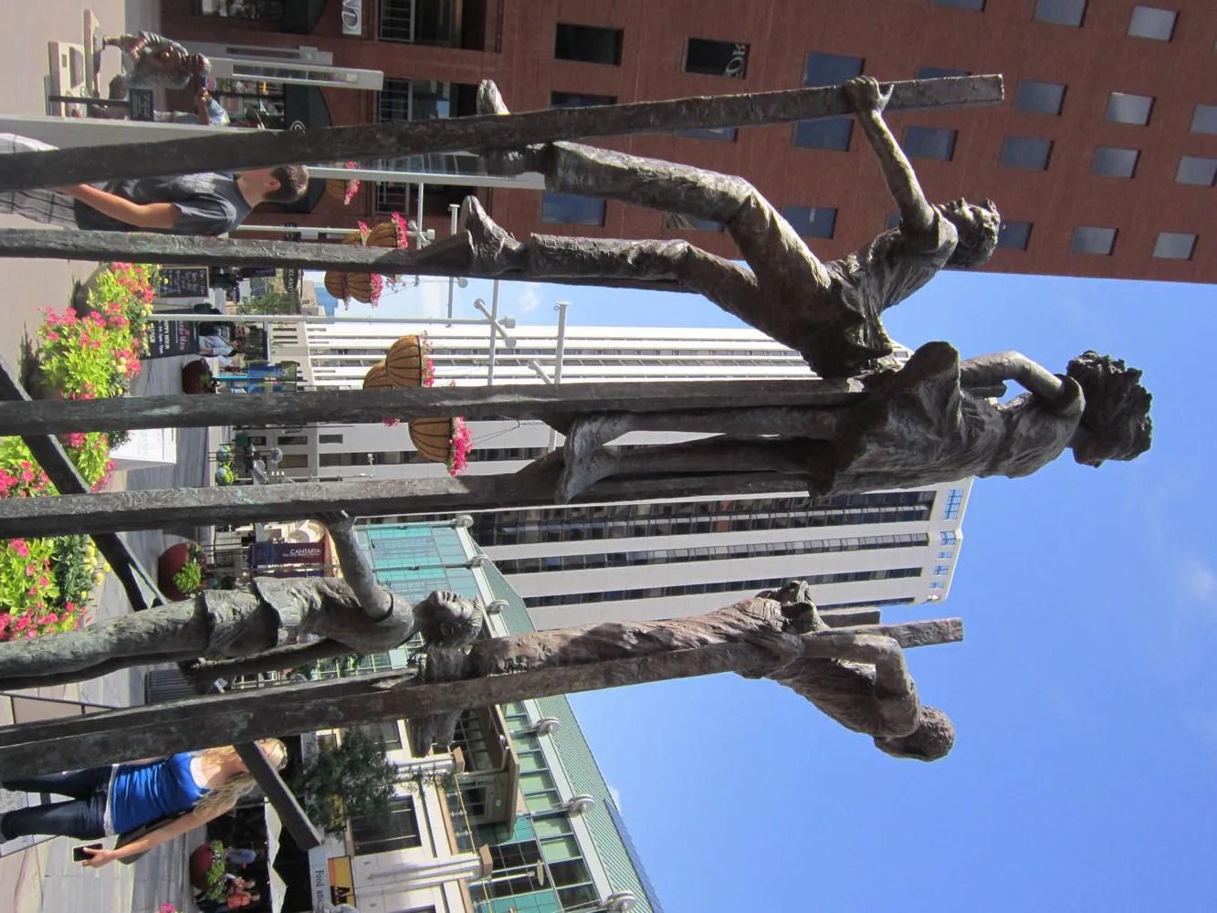 children on stilts statue, Denver, Colorado