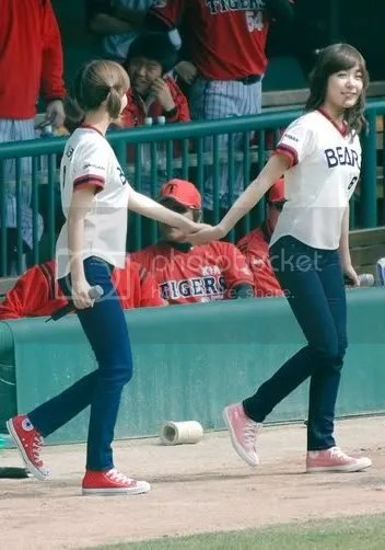 Jessica being dragged by Tiffany to the field