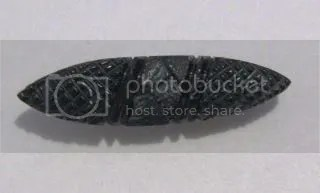 ABOVE: a typical hand carved Whitby jet mourning brooch.