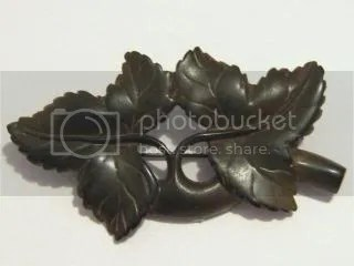 ABOVE: a Victorian antique Vulcanite morning brooch, depicting ivy (which means true love).