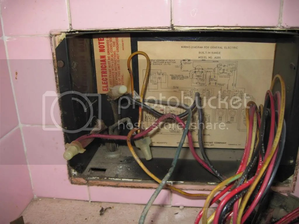 hight resolution of the other photo shows the wiring behind the drawers at floor level that i believe is not attached to the range
