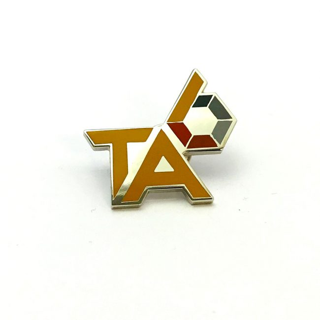 TA logo gold metal pin badge