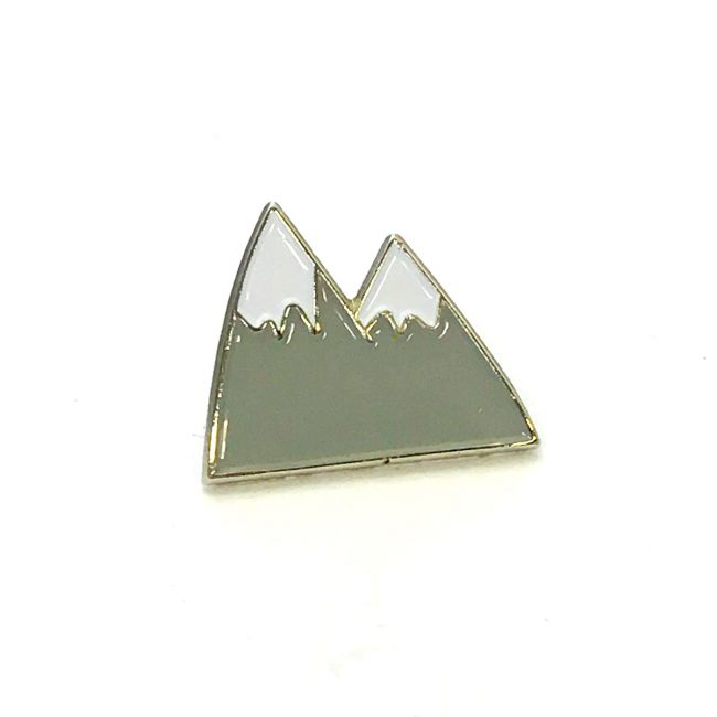 Grey mountain metal pin badge