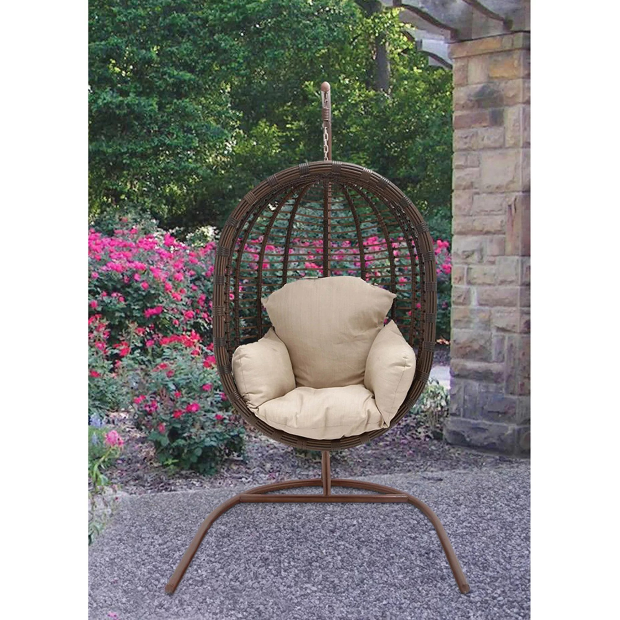 hanging chairs garden furniture movie theater for home hanover outdoor rattan wicker pod swing chair with full cream cushion walmart com