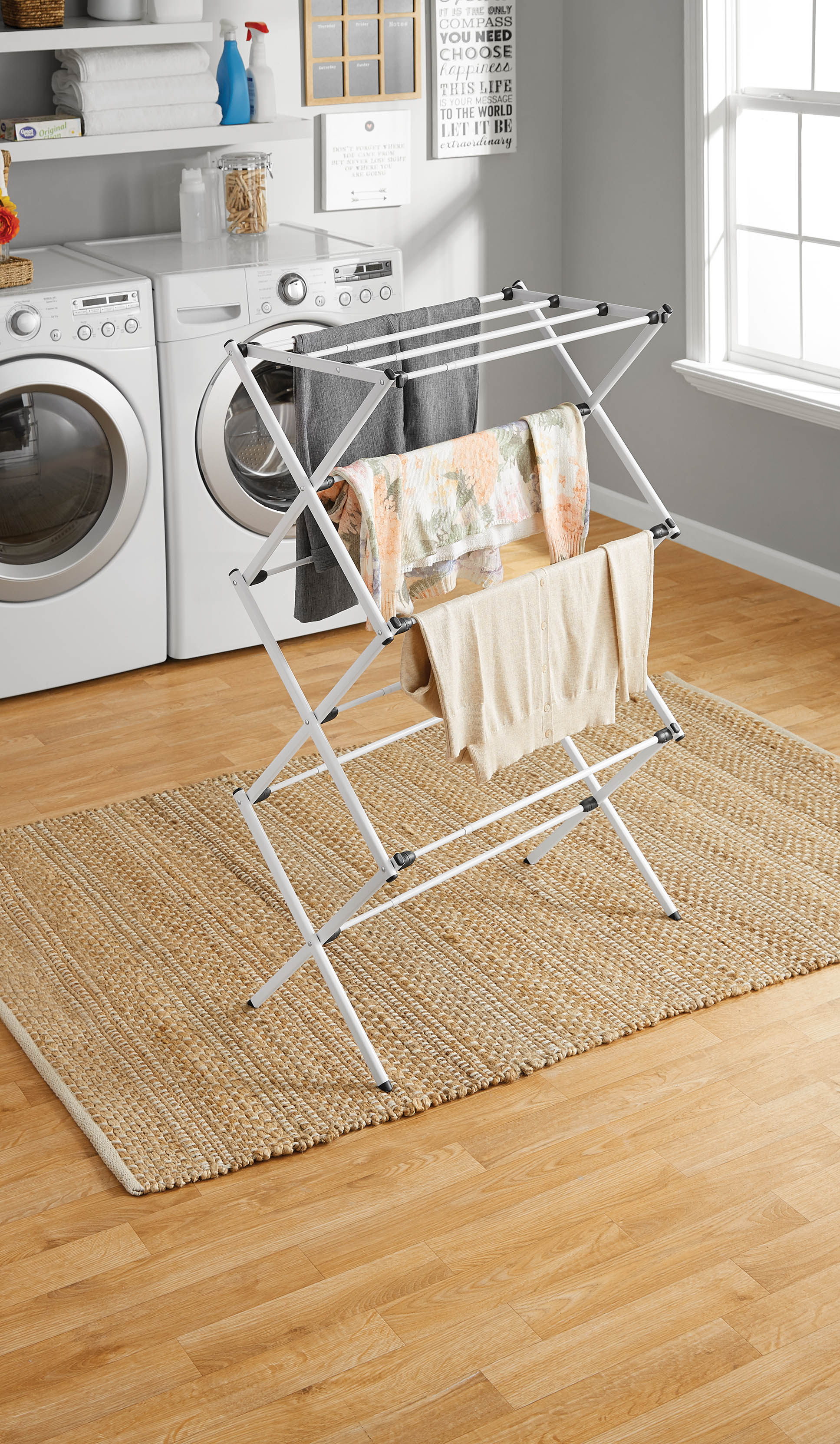 polder expandable laundry drying rack 50 8 ft of drying space folds to 2 17 in