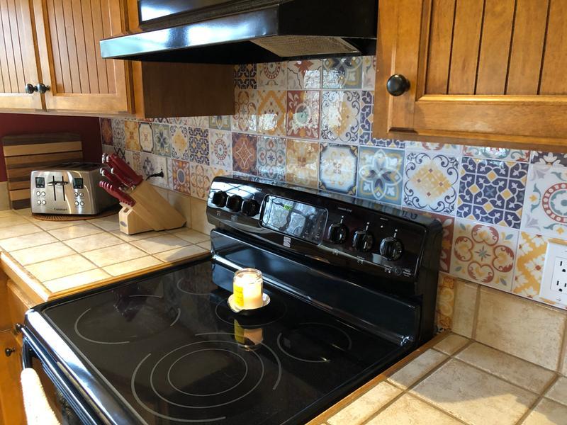 roommates spanish terracotta tile peel and stick backsplash wallpaper blue