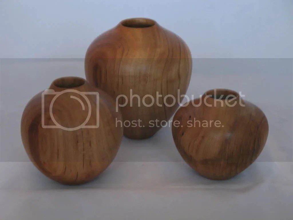 Three small cherry vessels
