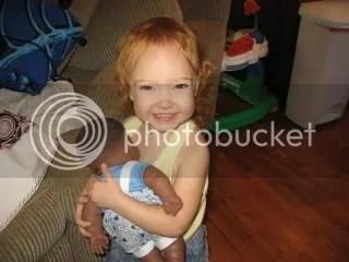 Trinity nursing a baby doll