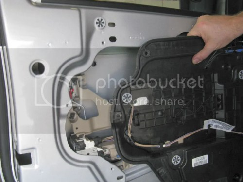 small resolution of separate the check strap from the hook remove the screws and separate the wire harness from the door remove the ten carrier plate screws and remove the