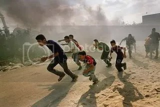 Kids in Palestine running away from war zone Pictures, Images and Photos