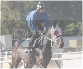 Jockey Dionicio Navarro rides Idaho Gem for the first time out of the San Joaquin County Fair gates Thursday morning. The 3-year-old is one of two cloned mules that will be racing at the fair this year. Craig Sanders/ The Record