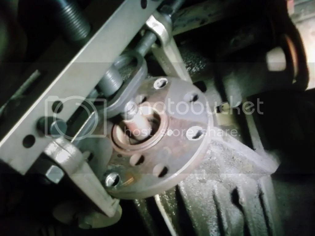 hight resolution of step 3 use the puller to remove the flange from the pinion shaft its very important to have a tapered end when pushing on the pinion shaft or the threads