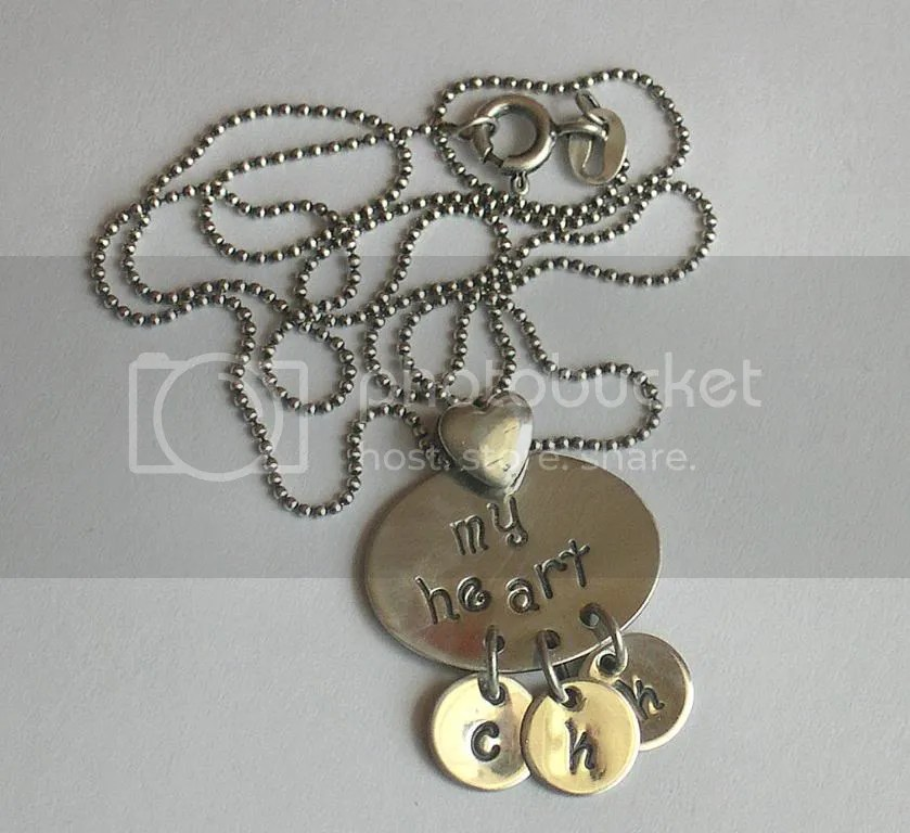 I originally designed this for my best friend.  It features her childrens initials.  Its been a popular design.  My Heart necklace is $60.00 with up to 3 initial dangles.  Additional dangles $1.50 ea.
