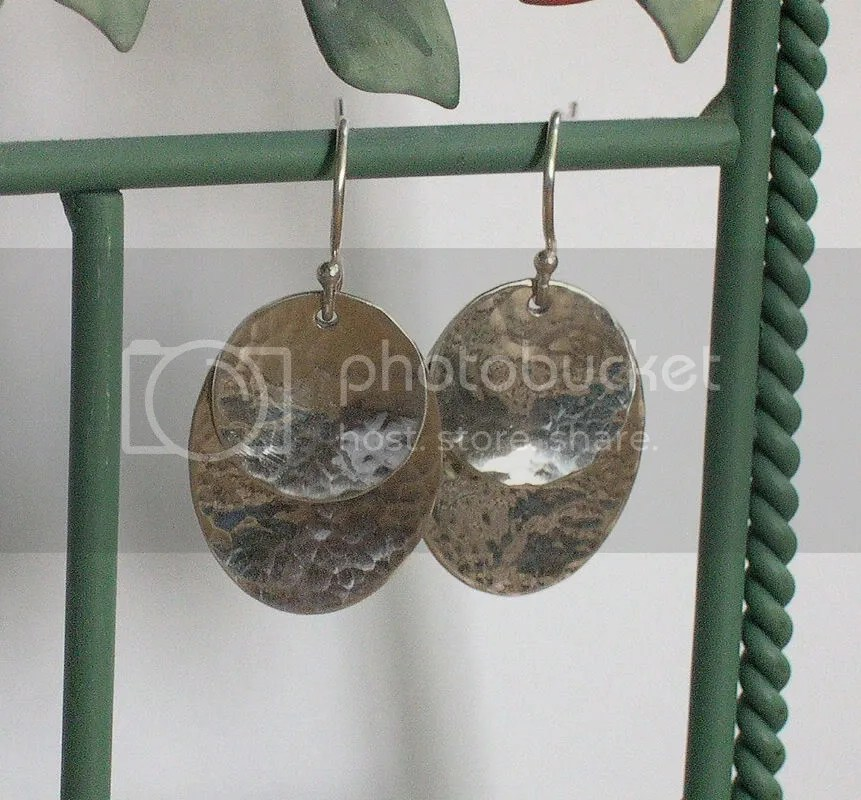 Hammered sterling silver earrings on French earwire.  Earrings hang 1.25 total.  $20.00