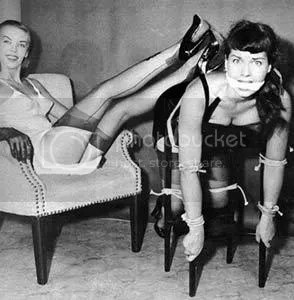 Note almost supernaturally gratuitous use of Bettie Page photo. Another devious demonik ploy to grab your attention!