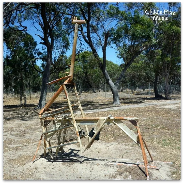 Huge giraffe ride-on, back-swing, at Katanning All Ages Playground