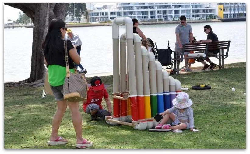 Children playing thongophone at Mandurah Children's Festival, 2013