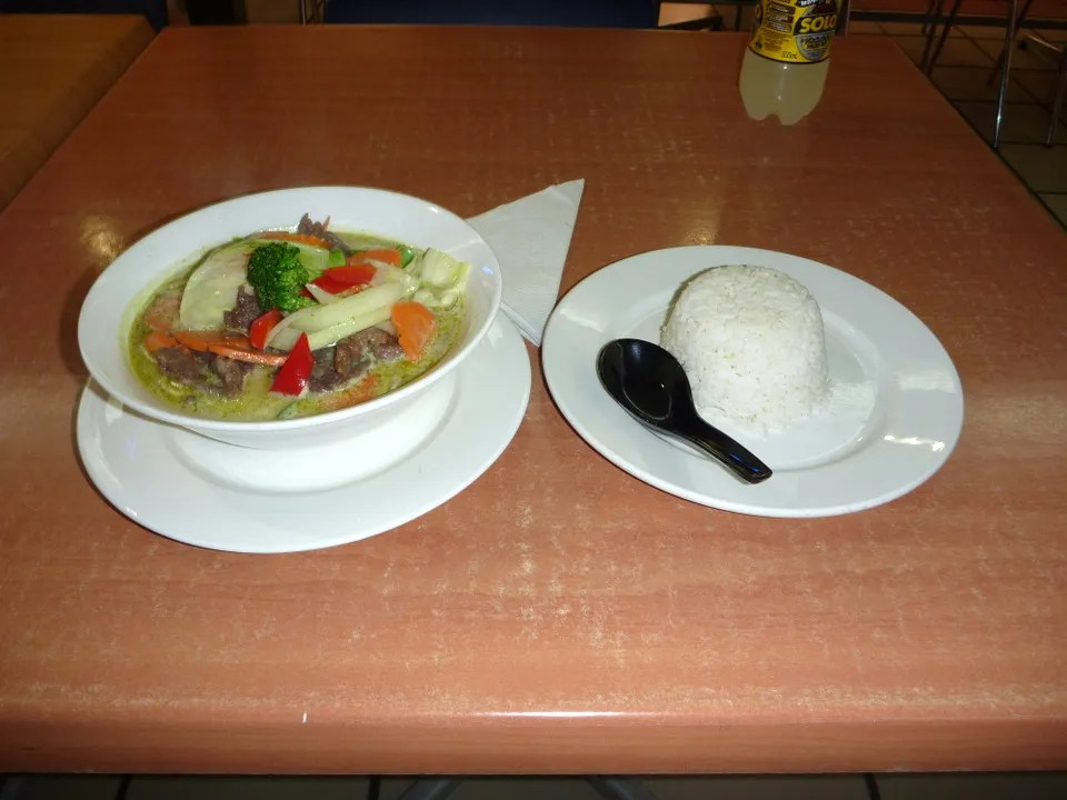 green curry and steamed rice from Mahar Fusion
