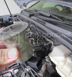 the yellow arrow shows the egr valve unfortunately the valve cannot be removed without removing the starter motor so you cannot check if the valve is  [ 1024 x 768 Pixel ]