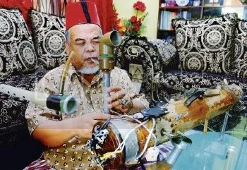 Abd Rahman Alabaladi with his home-made musical instruments