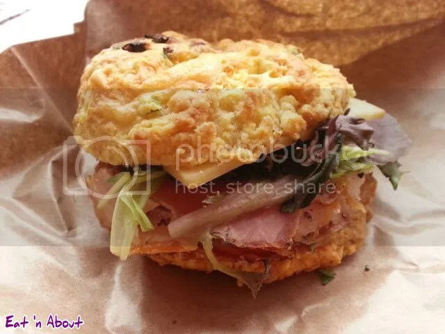 Beaucoup Bakery & Cafe Cheese Scone with Porchetta & Smoked Cheddar
