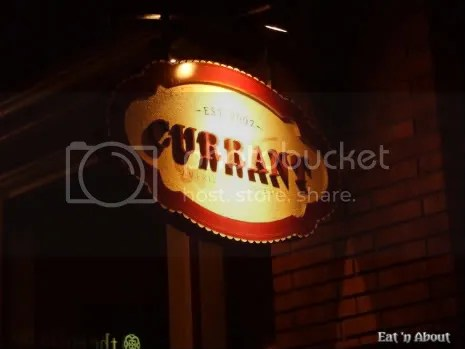 Currant American Brasserie sign