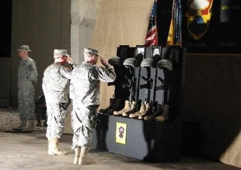 Saluting the Fallen photo Soldierssalutingfallenheroshelmets.jpg