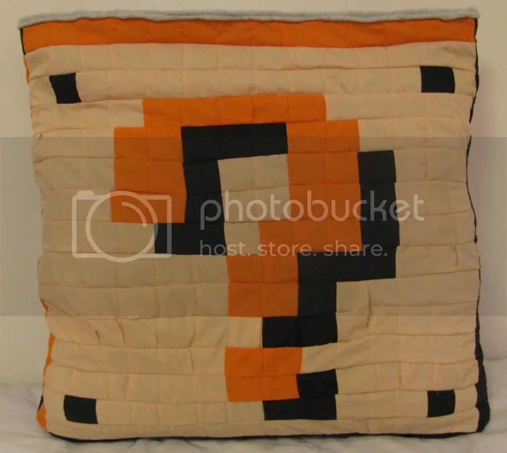 The quilt easily folds and flips inside out to be a pillow!