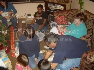 Me with Fiala, Wesley now on cousin Joshs lap, my Mom, Stepdad, and the tops of the heads of Ethan, Audrey and Grant
