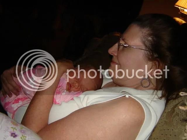 Grandmas in peaceful baby granddaughter heaven