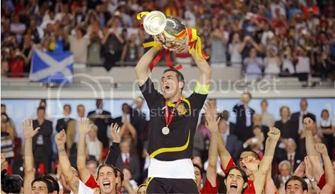 Goalie Iker Casillas raises the trophy