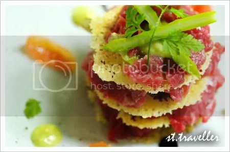 Beef fillet carpaccio on parmesan chips, puree of green asparagus, and cherry tomatoes with balsamic salad dressing.