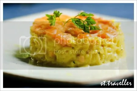 Saffron Risotto with salmon carpaccio and chives.