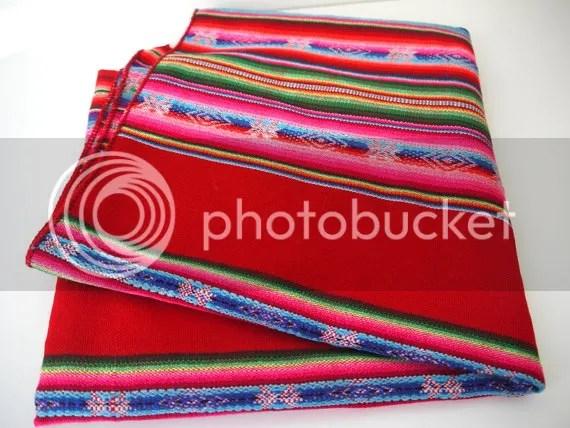 photo SouthAmericanFabricPeruvianFabricWovenTextileColorfulStripesBrightRed_zps648d77cd.jpg