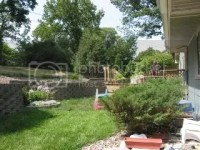 Ideas for sloping backyard and retaining wall